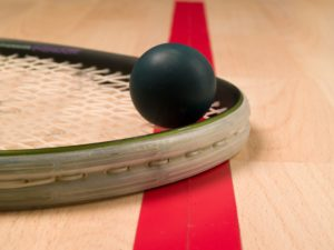 9010885 - squash racket and ball next to a red line